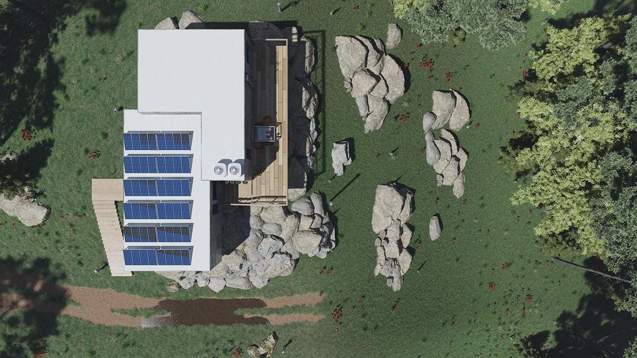 Top View of a Concrete House with Solar Panels and a Balcony