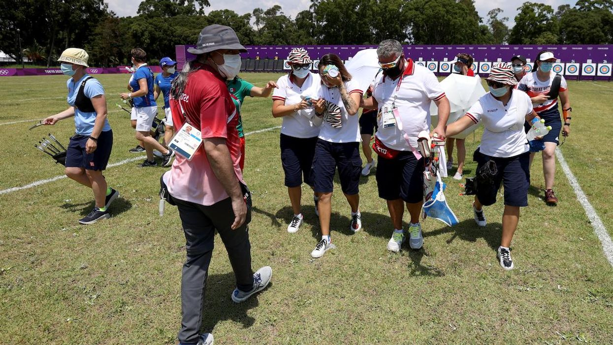 Archer Svetlana Gomboeva is treated for heat exhaustion at the Tokyo Olympics.