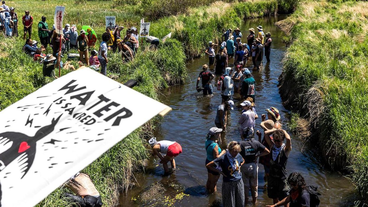 Climate activists and Indigenous community members gather on the river to protest the Enbridge Line 3 pipeline.