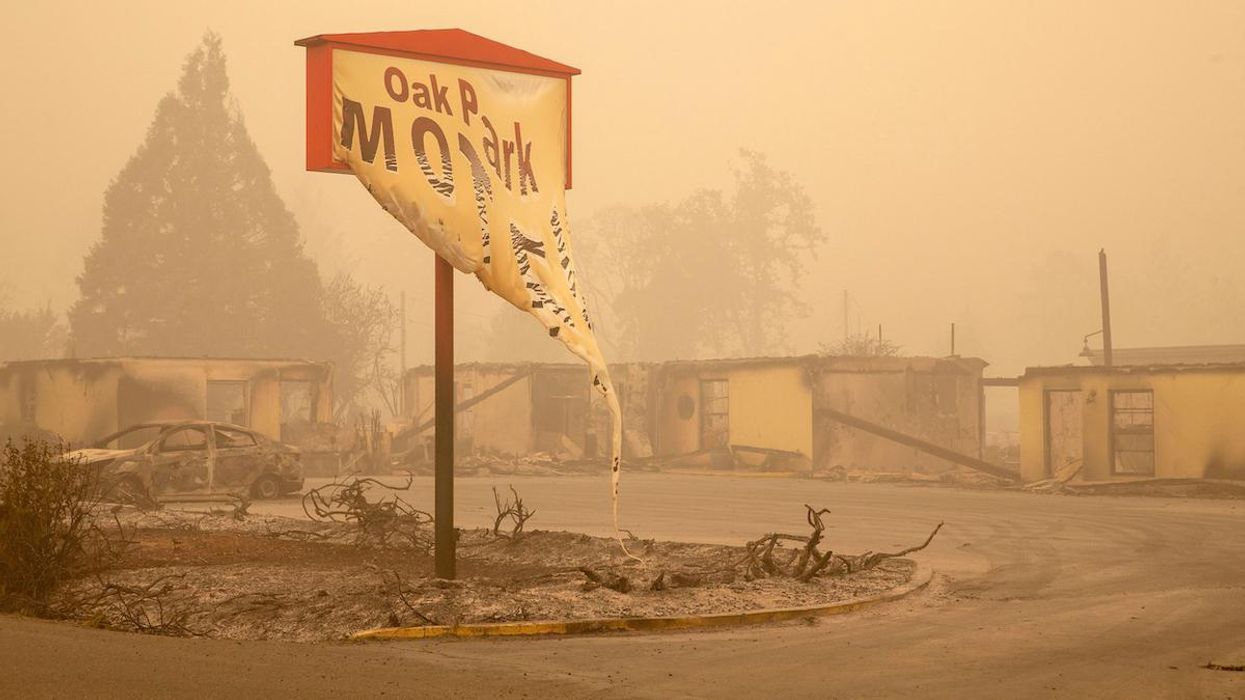 A motel sign destroyed by a wildfire in Oregon in 2020.