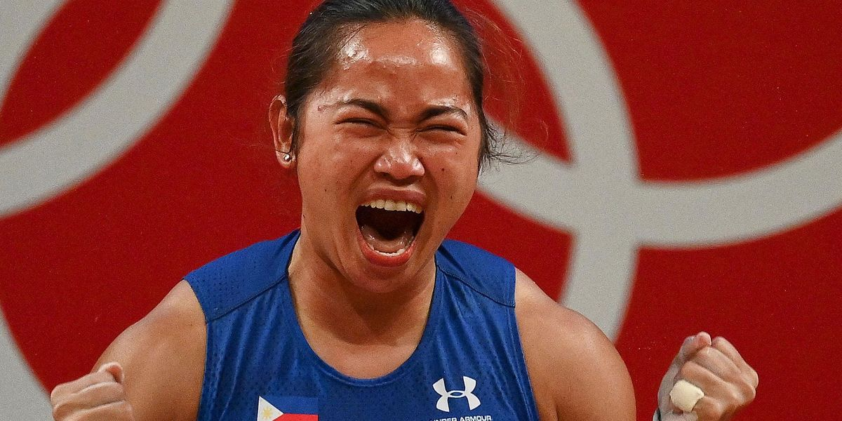 Philippines' Gold-Winning Weightlifter Hidilyn Diaz Was Forced To Train With Water Bottles