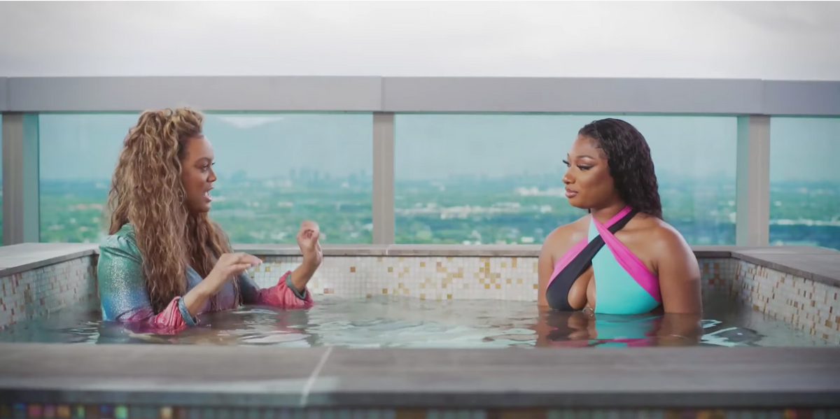 Not Tyra Banks Wearing a Maxi Dress in a Hot Tub