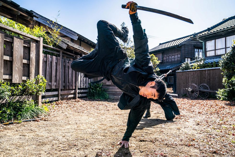 """Snake Eyes (played by Henry Golding) flips to avoid a sparring attack from Akiko (played by Haruka Abe) in """"Snake Eyes: G.I. Joe Origins."""""""