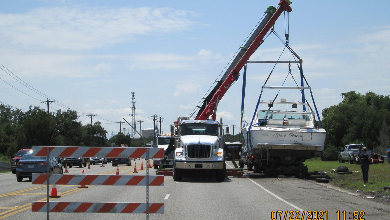 After 11 days ashore, 41-foot boat is removed from side of Bee Cave highway