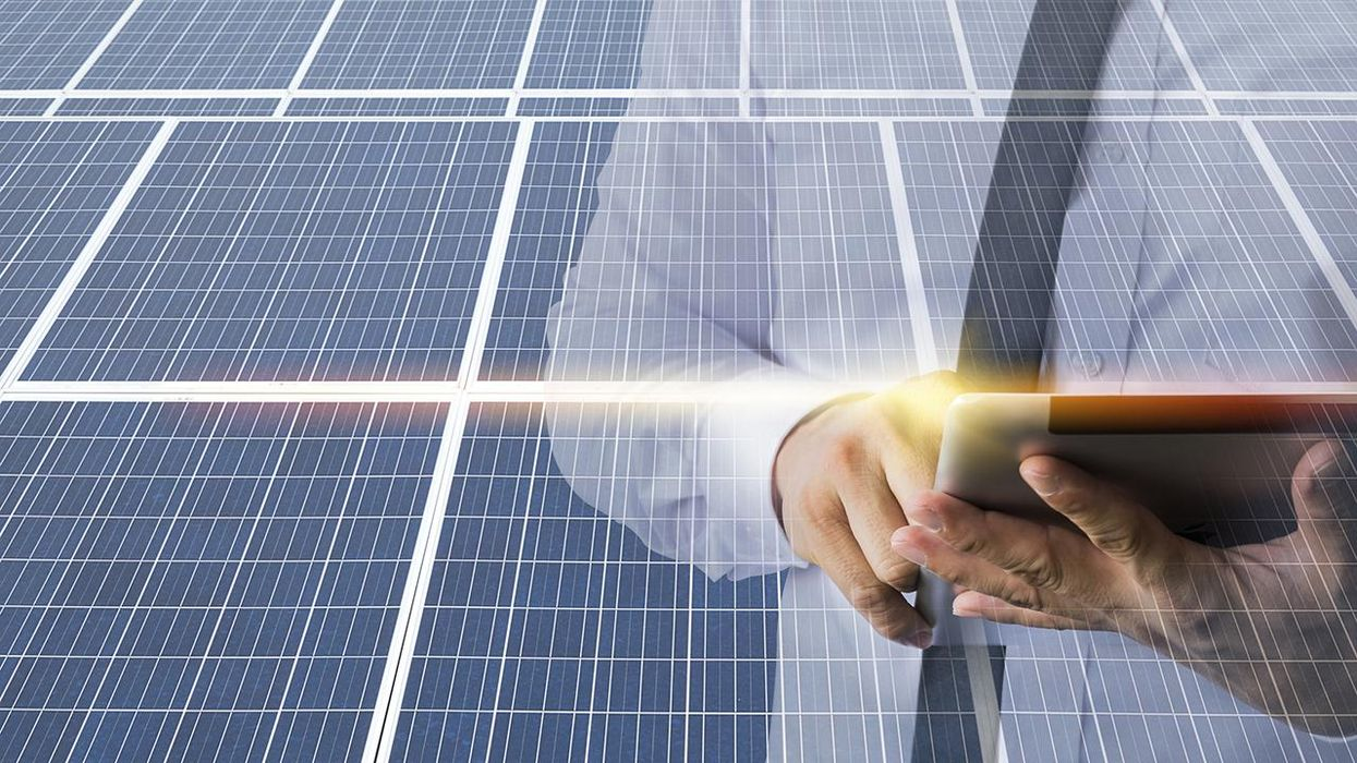 Businessmen calculate investment, renewable energy, solar cell. The man wear a white shirt, work with a tablet.