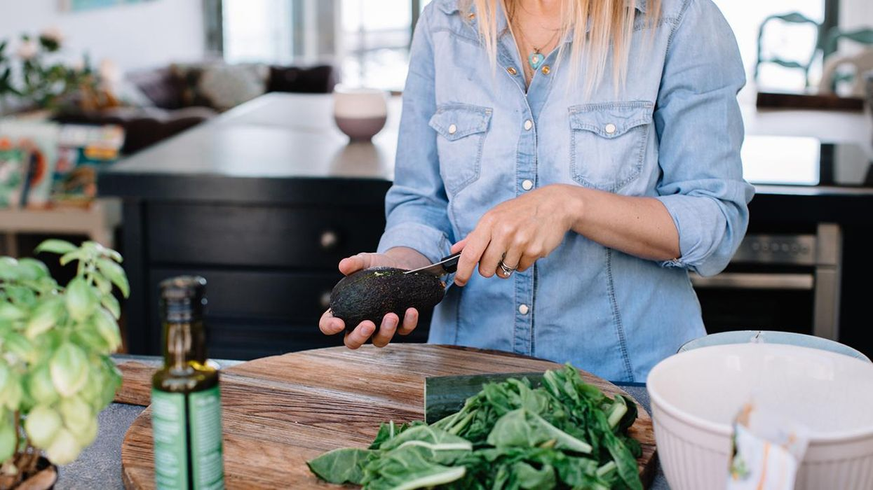 Preparing healthy food at home in kitchen