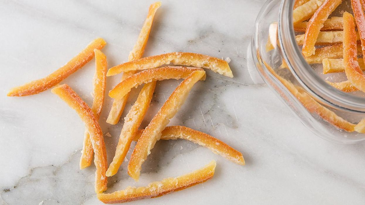 Candied Orange Peel on a white marble with a jar