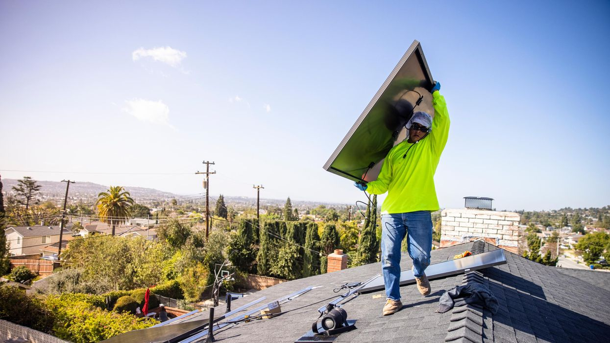 A team of workers installing solar panels on a home in Southern California
