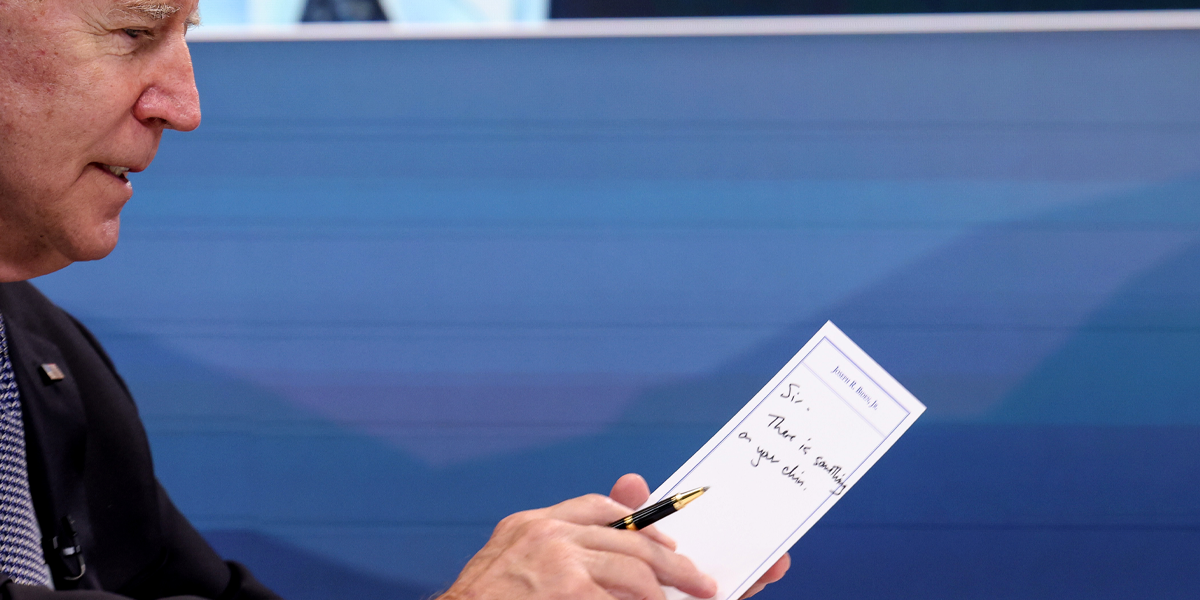 Joe Biden Accidentally Reveals Note Saying 'Sir, There's Something on Your Chin' During Meeting