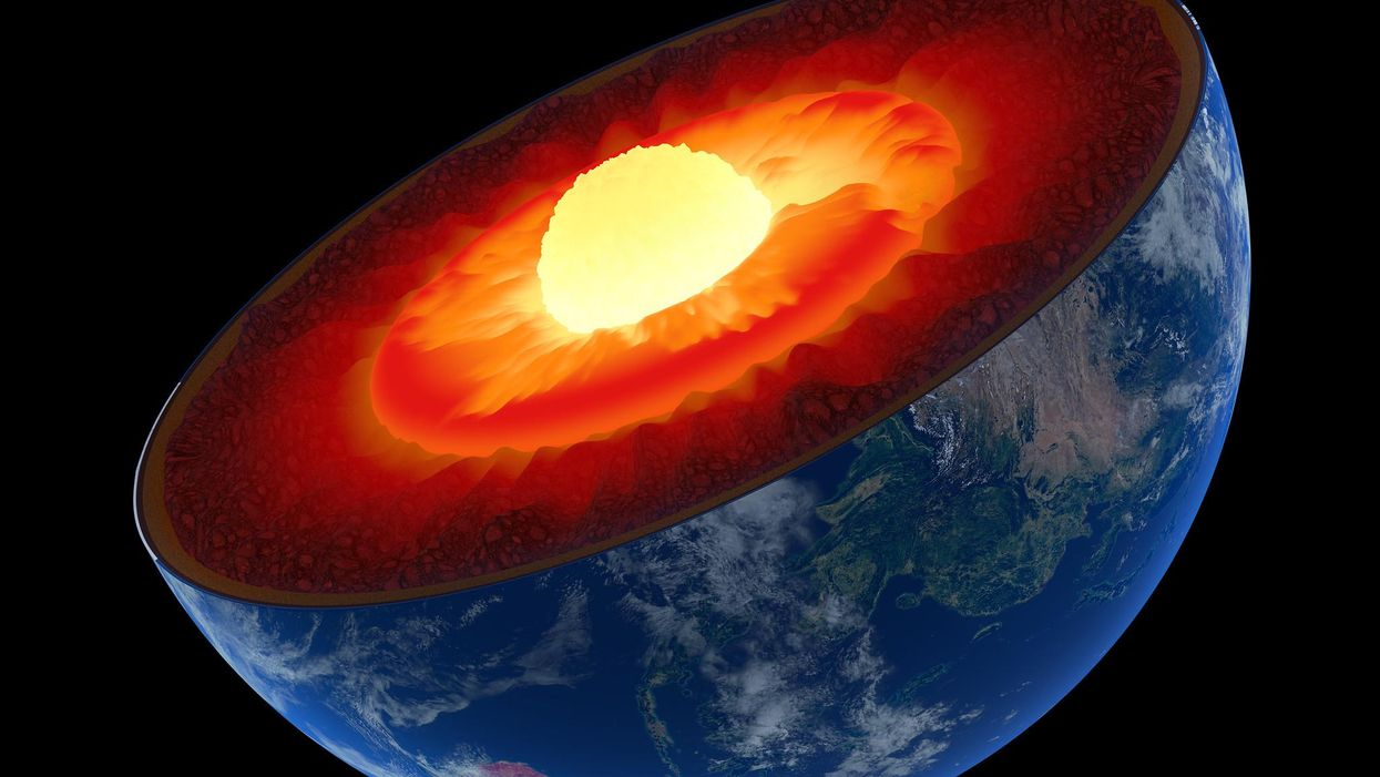 Earth's solid metal inner core is growing more on one side than the other