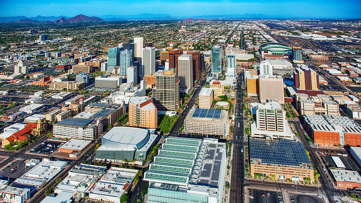 A wide angle aerial view of downtown Phoenix, Arizona and the surrounding urban area.