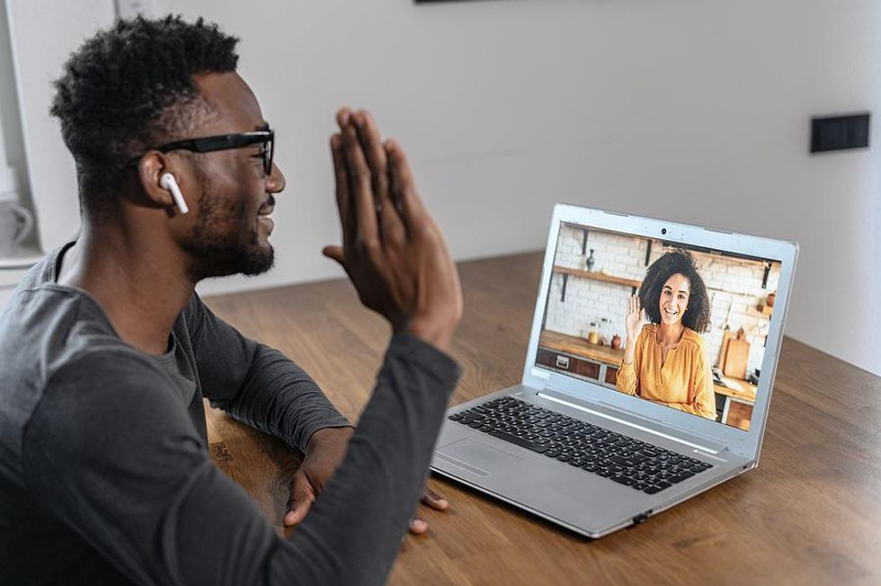 Man on a video call with someone on his network