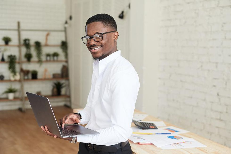 Man happy at work after changing careers