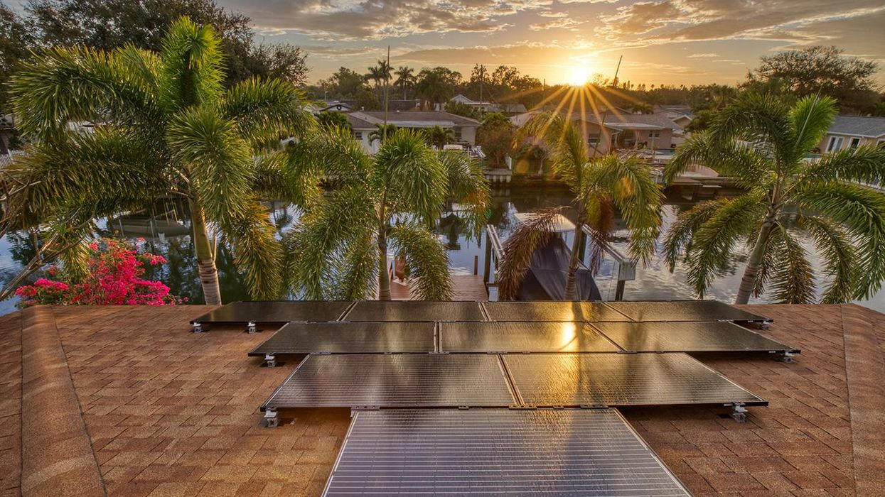 Solar panels on a residential house in Florida with the sun just starting to rise