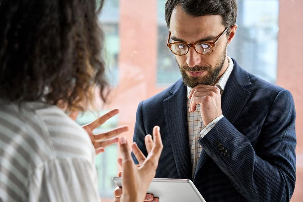 Woman talks to her boss about stress