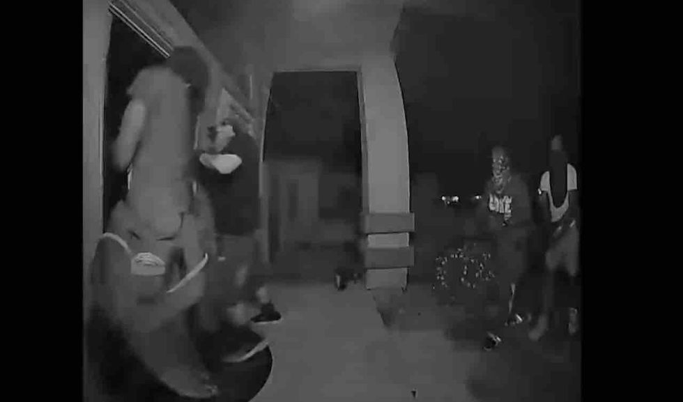WATCH: Crooks break down home's front door in dead of night. But homeowner has a motion sensor — and a gun — just waiting for them.
