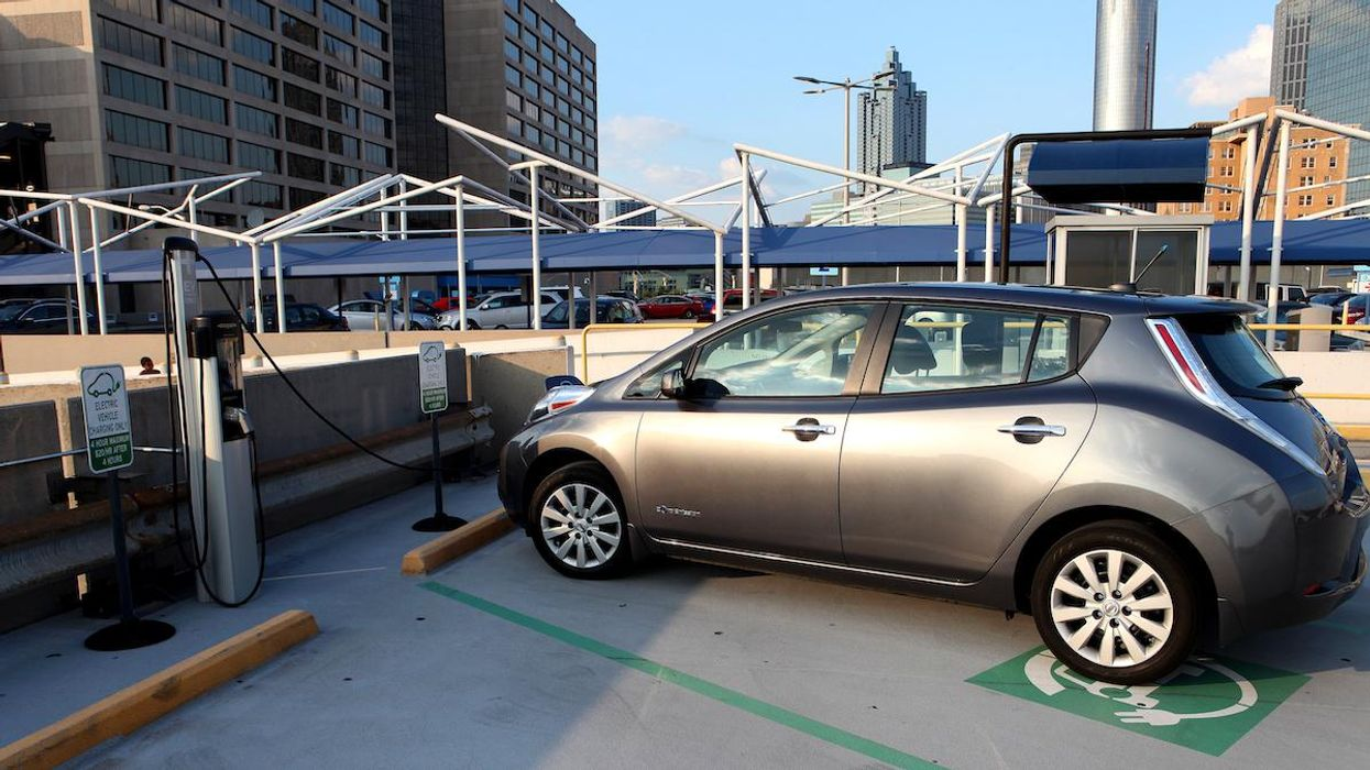 A car charging at an electric vehicle charging station.