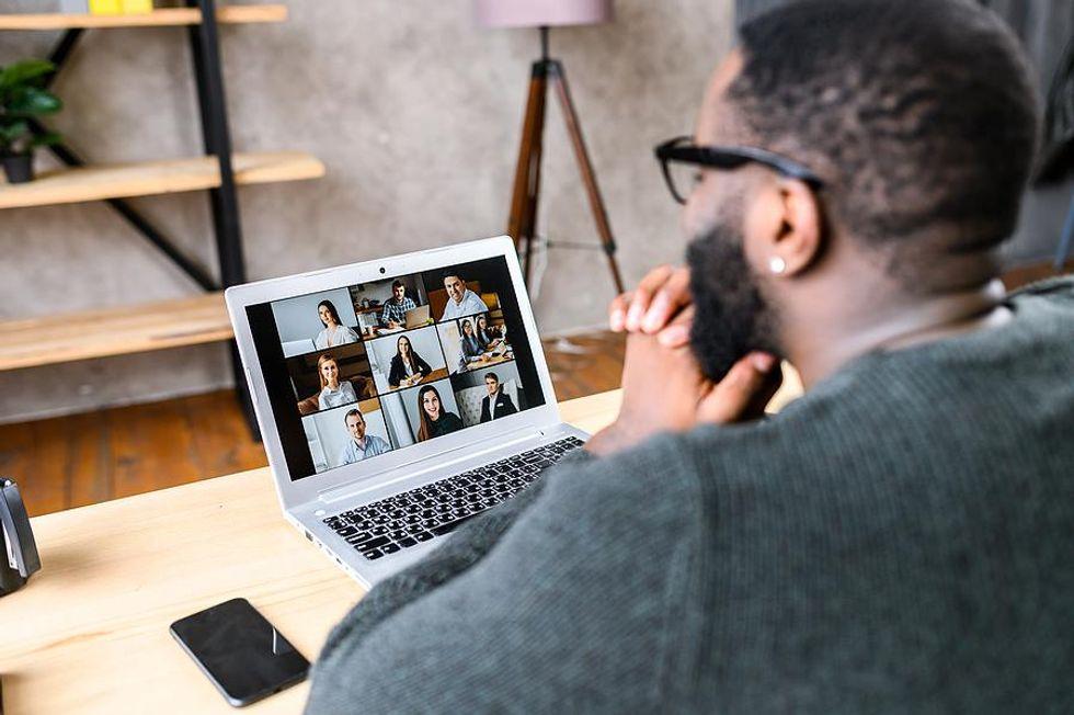 Man attends an online networking event