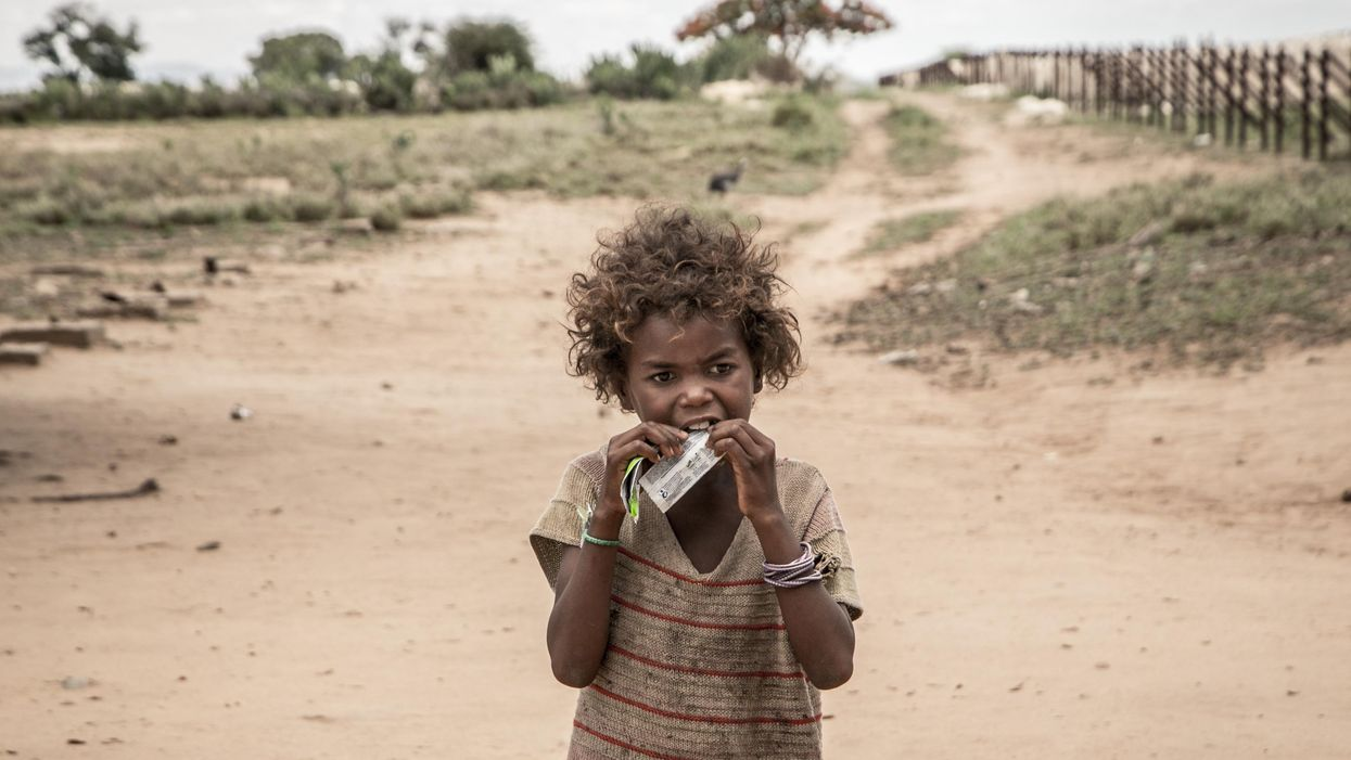 girl eats a food supplement in Madagascar