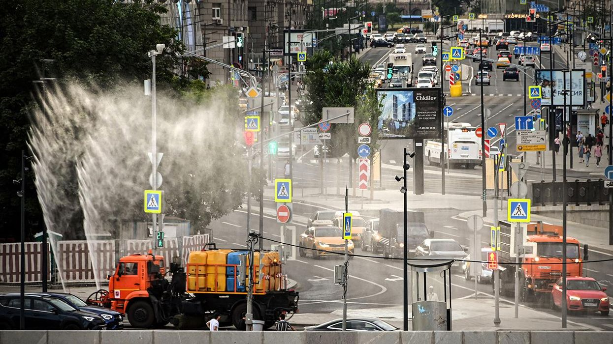 Municipal vehicles sprinkle water in downtown Moscow