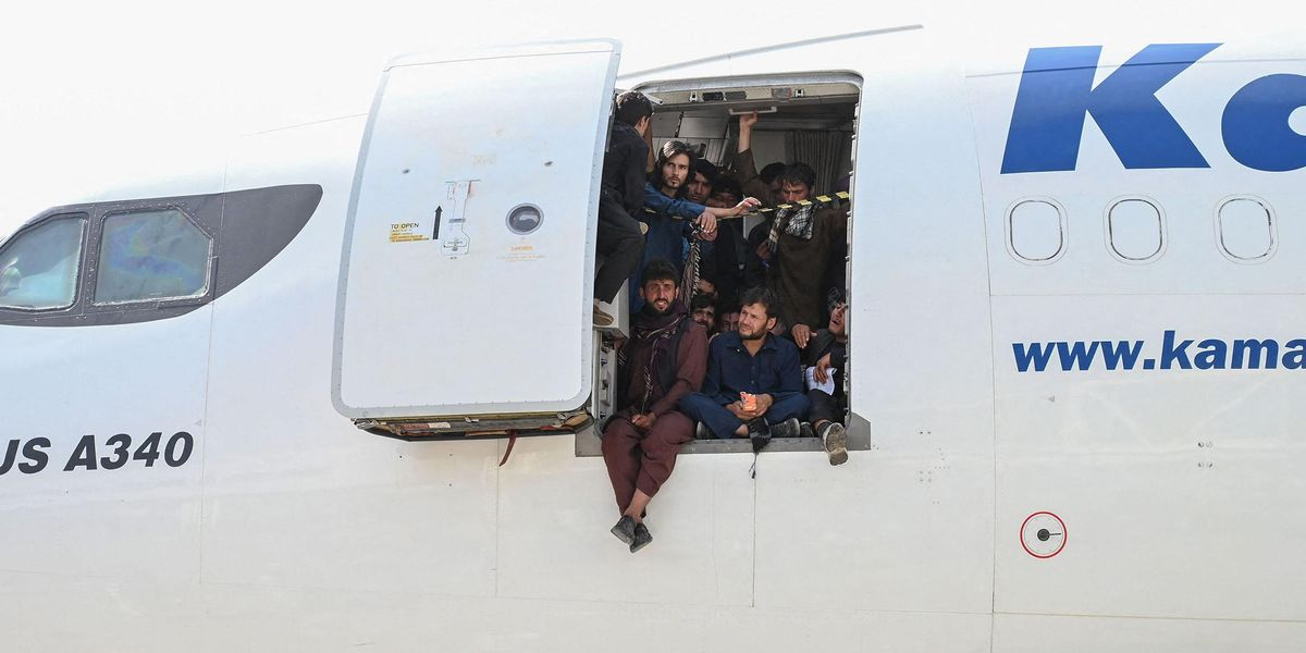 Video Shows Crowd Scaling Jet Bridge To Try and Force Their Way Out of Afghanistan