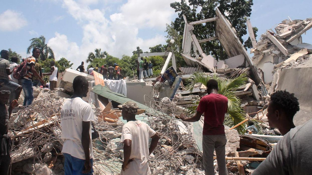 A hotel in Haiti reduced to rubble by an earthquake.