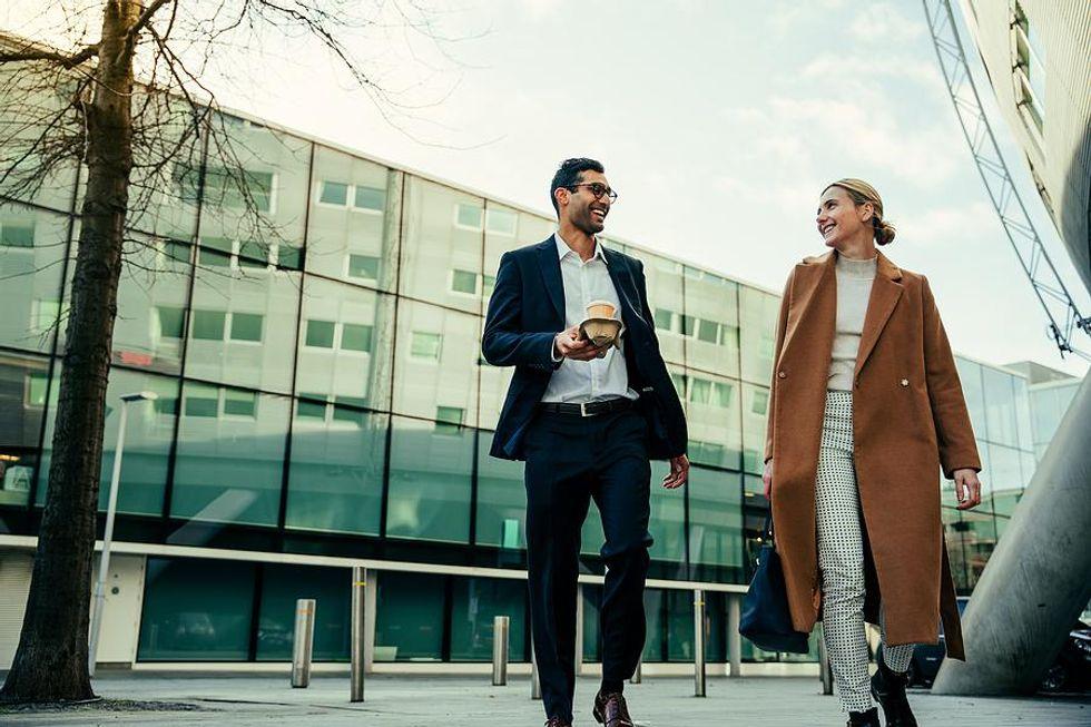 Man and woman take a walk at work