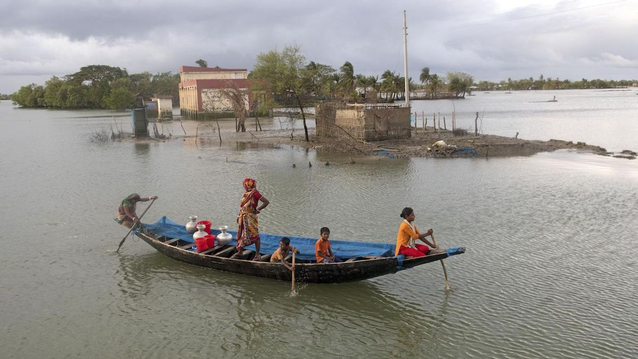 People in Bangladesh evacuate from catastrophic flooding.