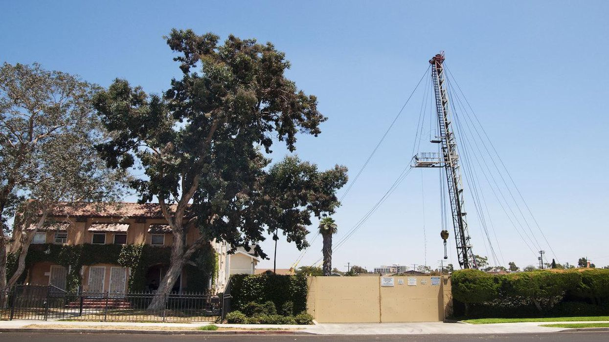 A house in Los Angeles next to an oil drilling site.