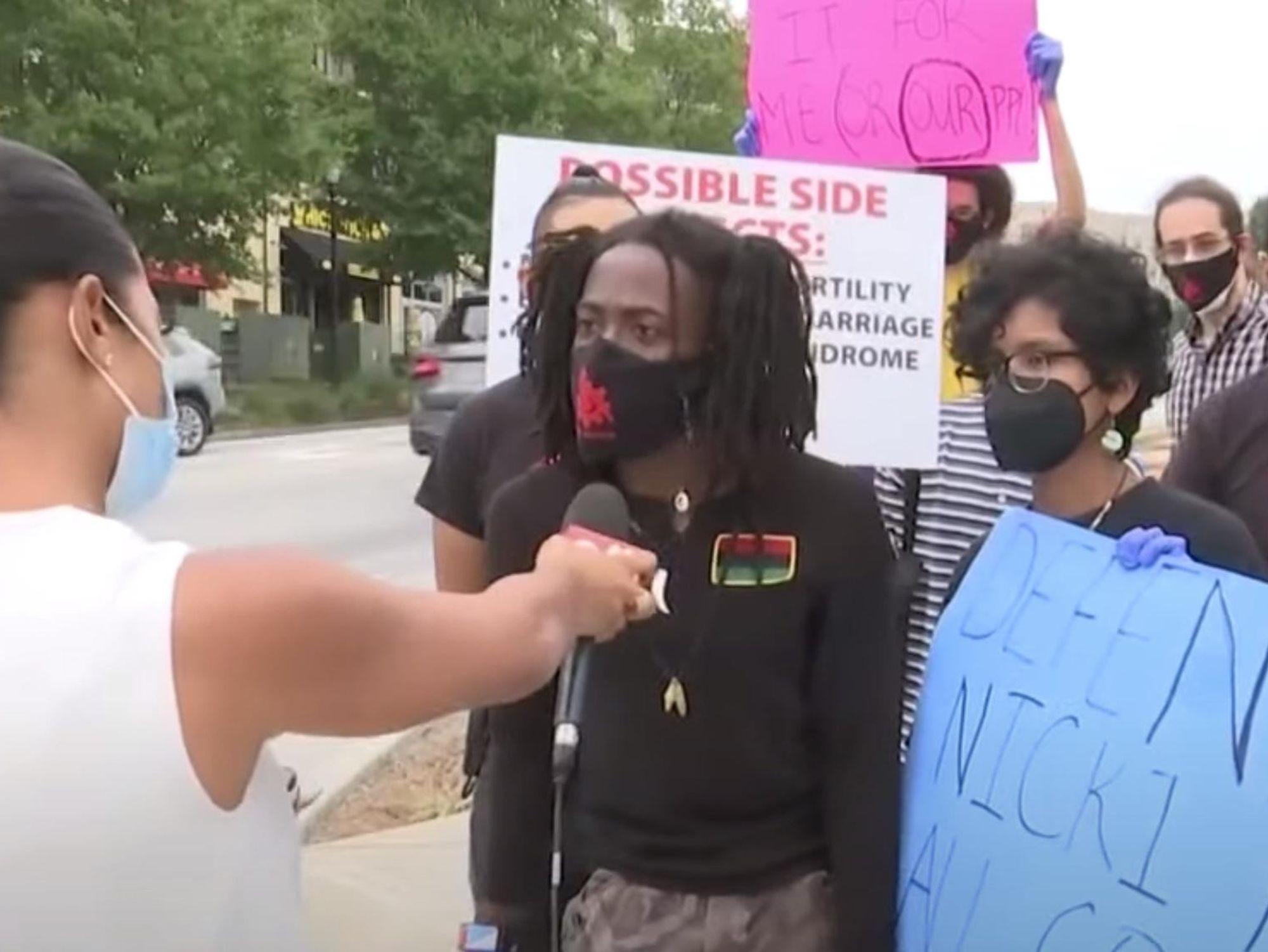 Fans of rapper Nicki Minaj protest against vaccine mandates outside the CDC headquarters in Atlanta