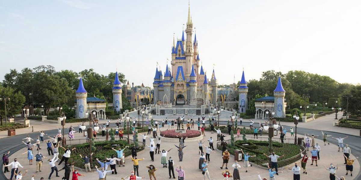 Disney employees march through Disney World to protest company's vaccine mandate