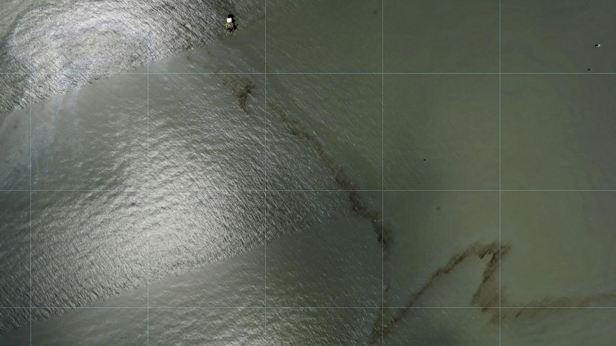 A photo from NOAA shows a miles-long black slick floating in the Gulf of Mexico.
