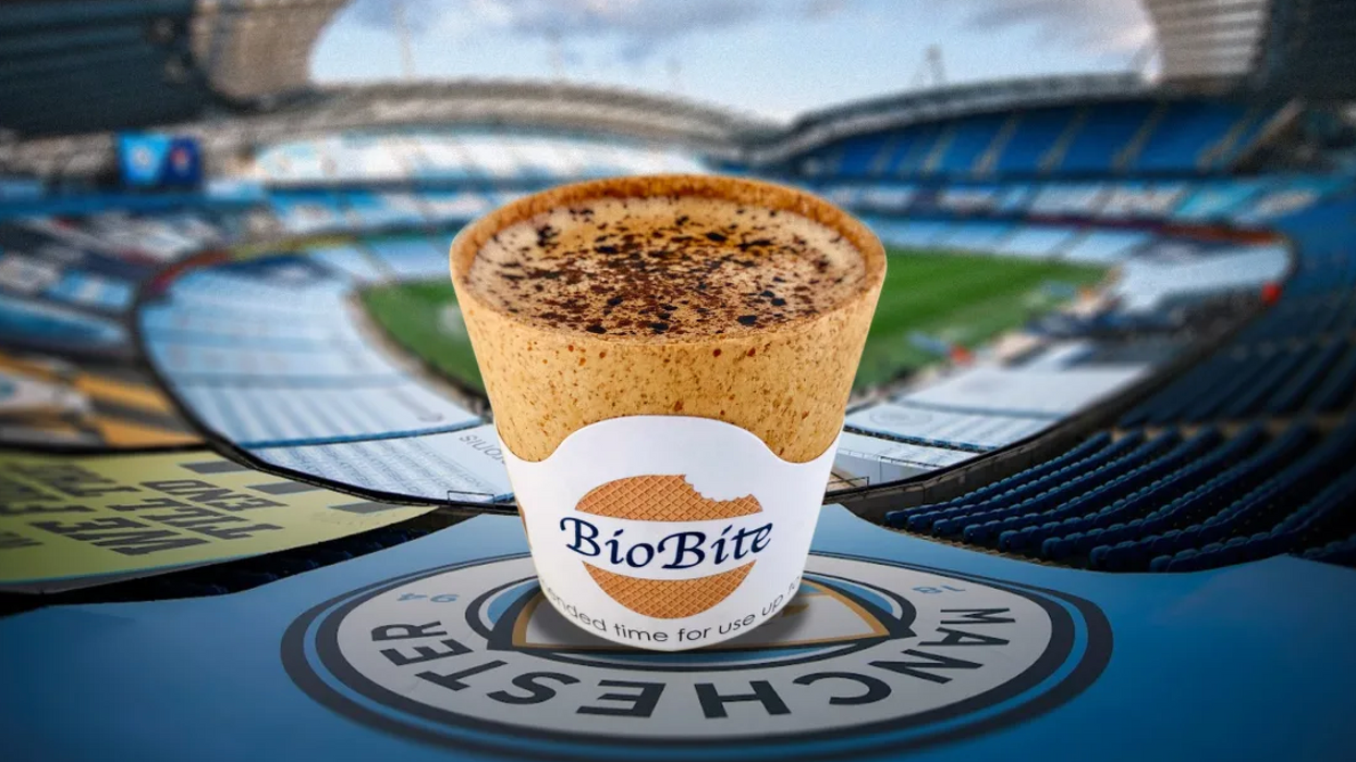edible coffee cup with soccer stadium background