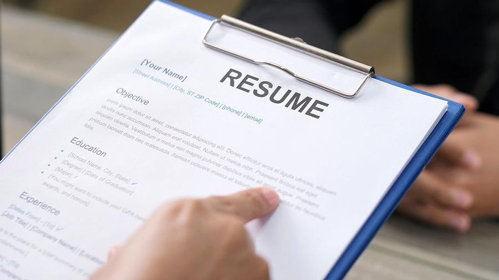 Hiring manager refers to resume during a job interview