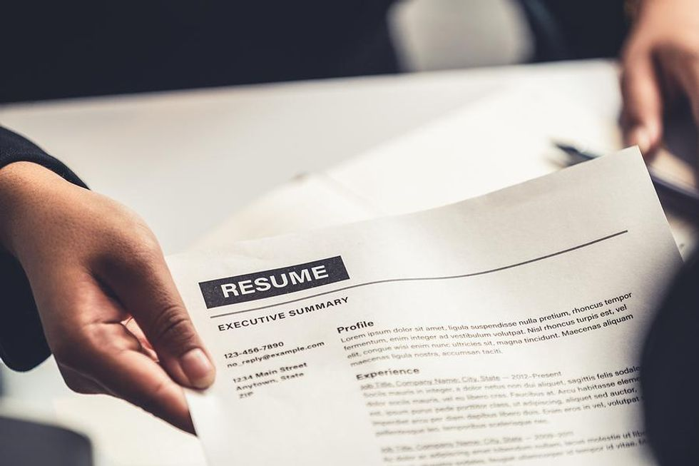 Job candidate gives the hiring manager their resume