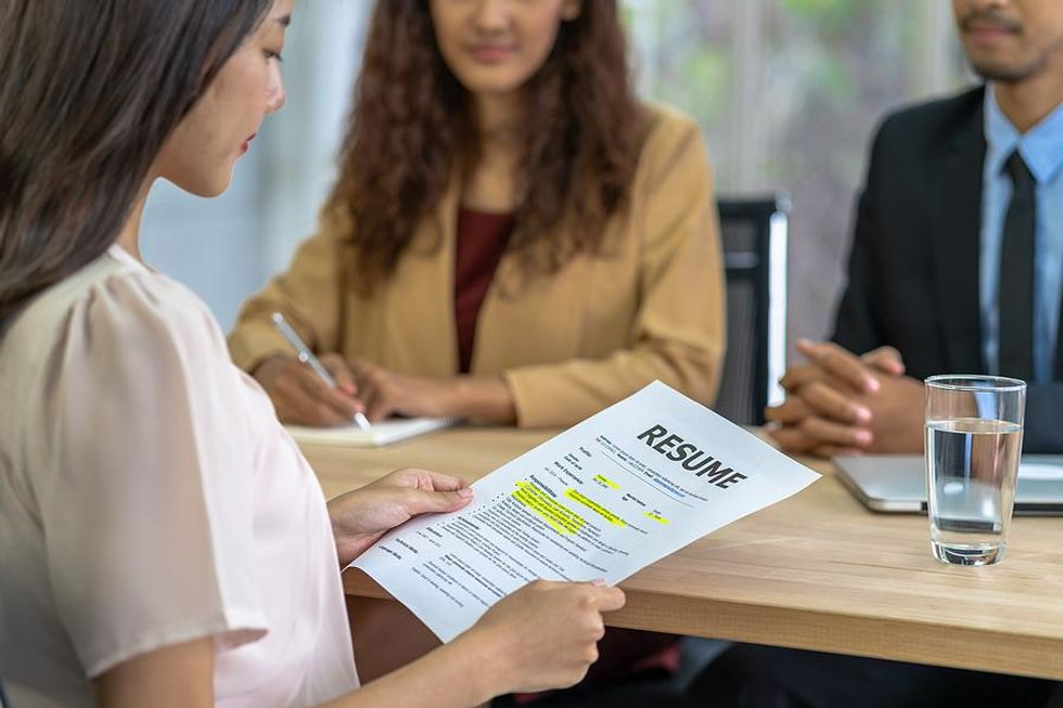 Woman reviews her resume before a job interview