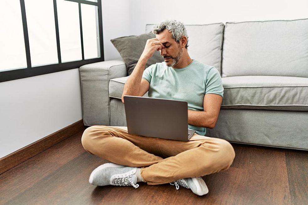 Man stressed about finding a new job