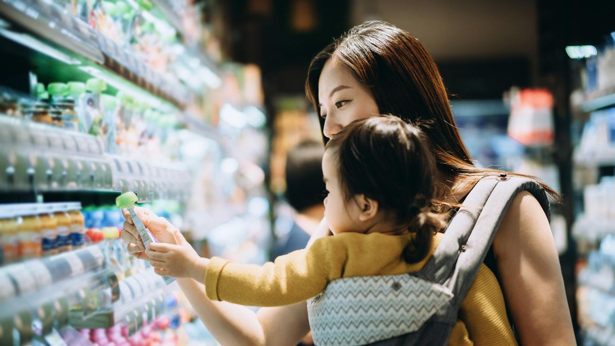 mother grocery shopping with little daughter