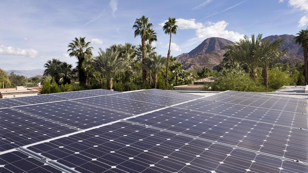 Wide angle image of a group of solar panels on top of a home in the city of Indian Wells, California.
