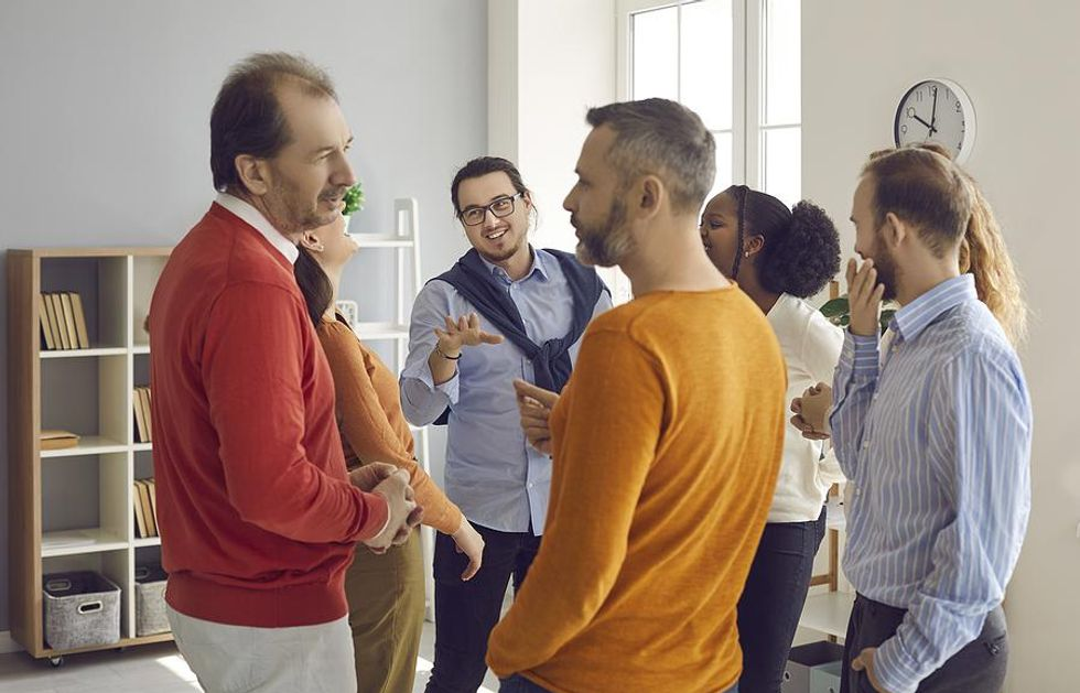 Two men talk at a networking event