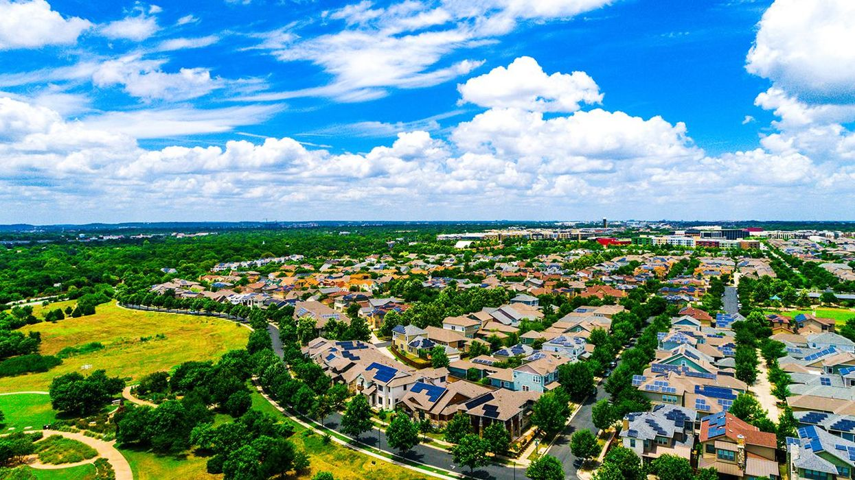 Austin Texas suburb solar energy production to fight climate change. Aerial drone view