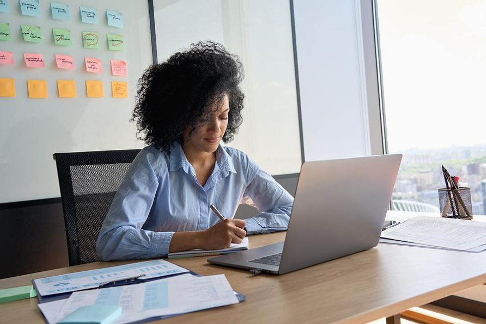Woman fixes a mistake on her executive resume