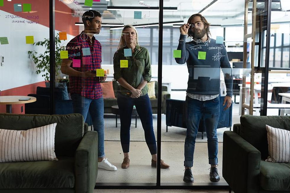 Coworkers work on challenging tasks together