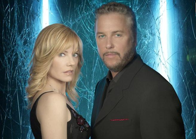 Marg Helgenberger and William Petersen pose in front of a background of cracked glass