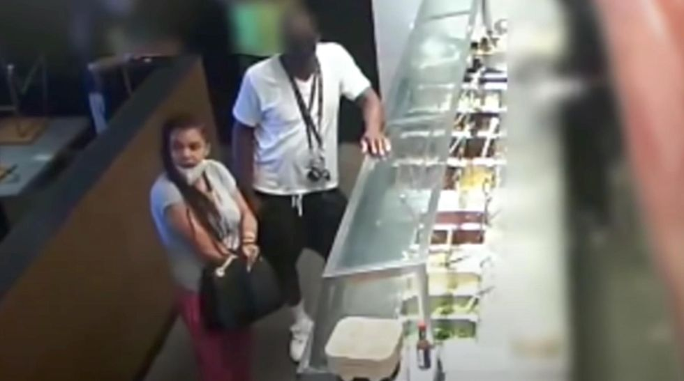 WATCH Video shows woman pulling a gun from her purse after Chipotle tried to close early: 'Somebody better give me my food!'