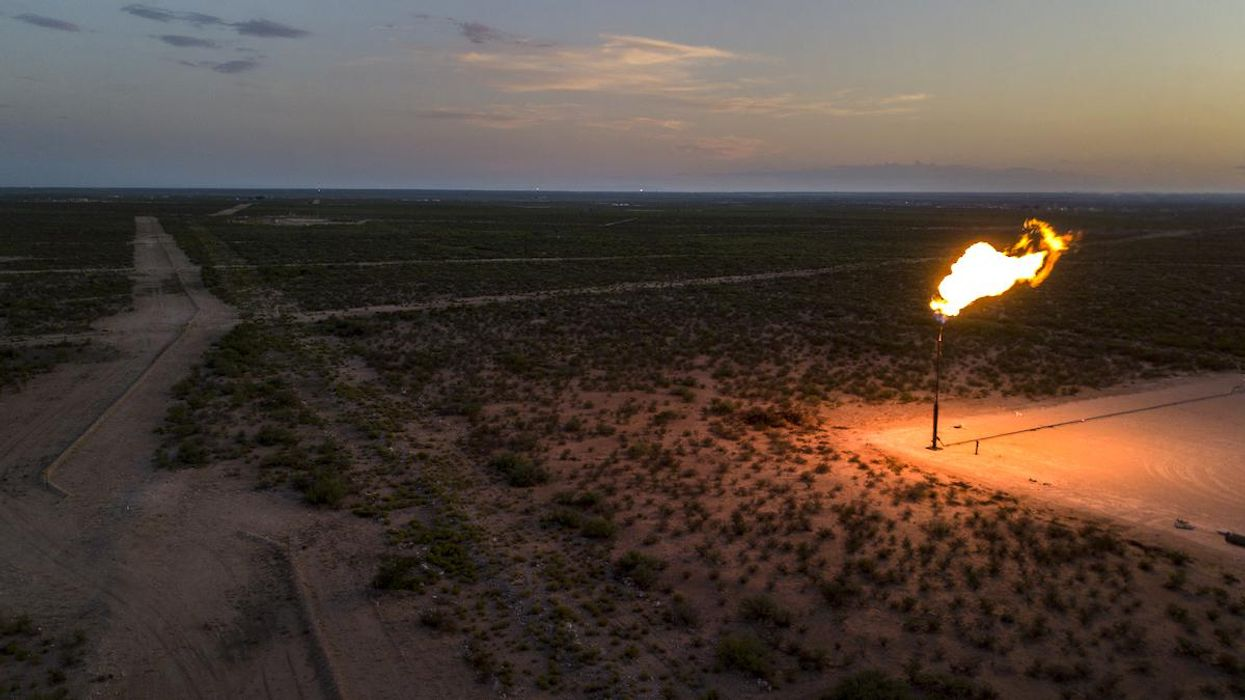 A gas flare burns in the Permian Basin in Texas.