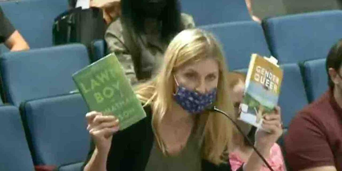 WATCH: Furious mother exposes 'pedophilia' in HS library books, reads explicit passages to school board — until official warns her: 'There are children in the audience'