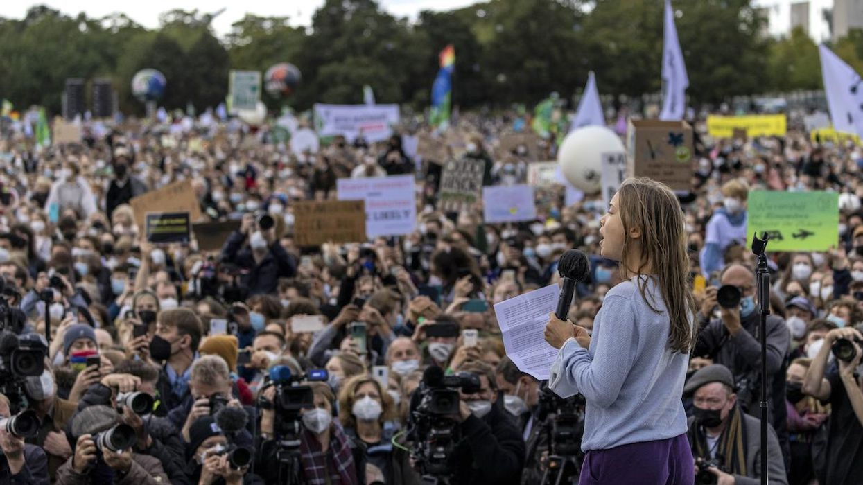 Climate activist Greta Thunberg speaks at a large-scale climate strike march.
