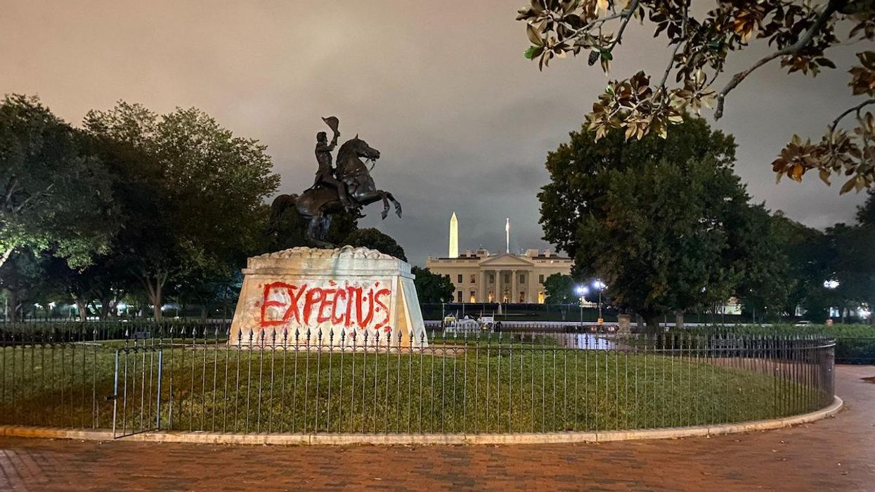 """IEN organizers wrote """"Expect Us"""" on the statue of Andrew Jackson in front of the White House."""