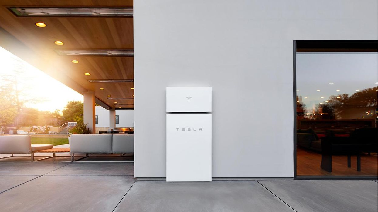 Side of home with Tesla Powerwall+ battery
